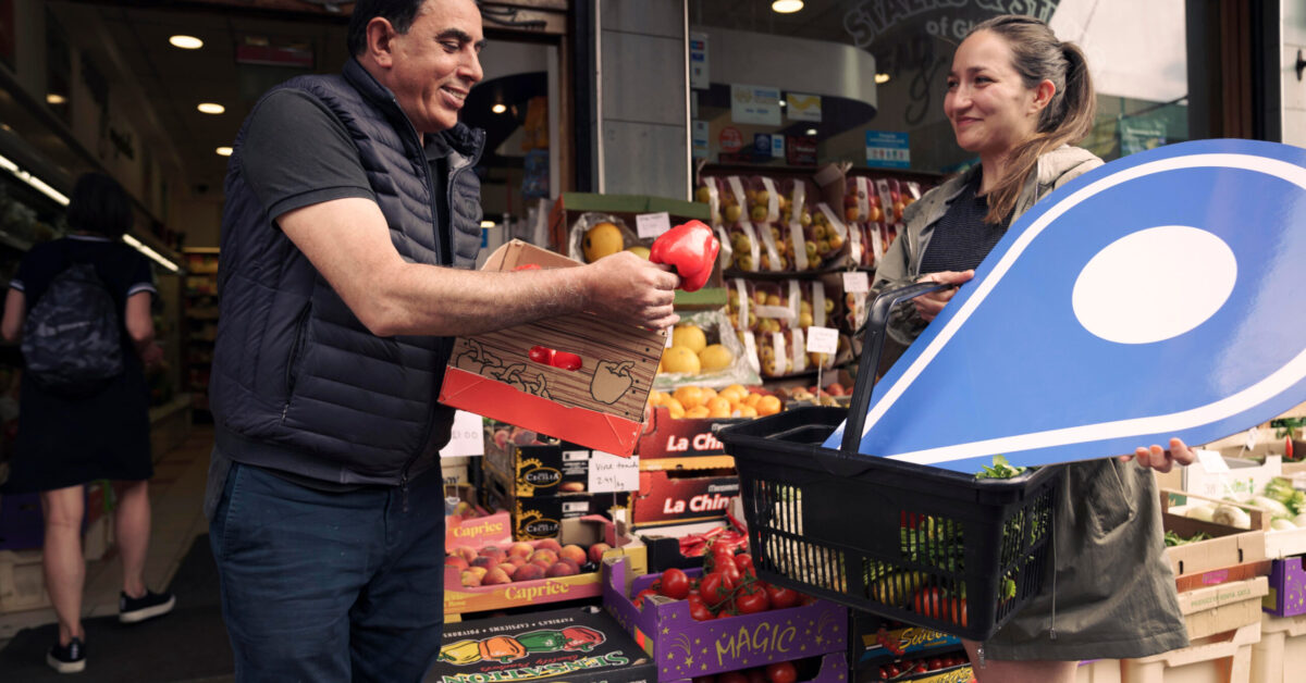Free first use: Ali Haider (BOTH CORRECT), owner of Stalks and Stems Florist and Greengrocers, left, chats with customer Giuliana Torpiano (BOTH CORRECT). The business, on Pollokshaws Road, Glasgow, is one of several in Shawlands promoting the Scotland Loves Local campaign, encouraging people to choose local and back businesses in their community as part of the national recovery from the Covid-19 pandemic. The campaign is spearheaded by Scotland's Towns Partnership.  Media enquiries to Chris Story on 07375 065 728 / chris@messagematters.co.uk